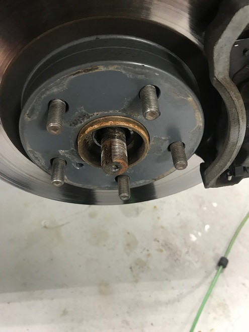 Remove front axle nut