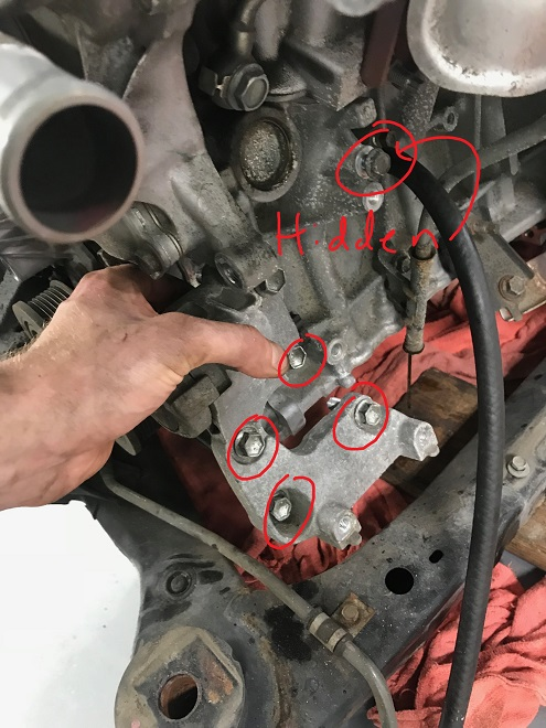 Hidden bolt and removing the tensioner