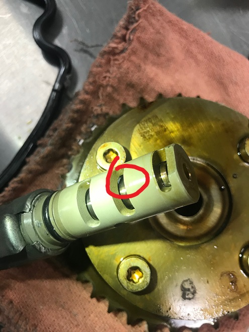 Oil control valve debris